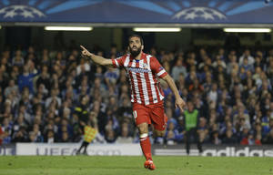 Photo - Atletico's Arda Turan celebrates after scoring his soda's 3rd goal during the Champions League semifinal second leg soccer match between Chelsea and Atletico Madrid at Stamford Bridge Stadium in London Wednesday, April 30, 2014. (AP Photo/Kirsty Wigglesworth)