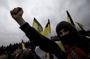 photo -   Ultra nationalist demonstrators and activists shout anti-government slogans as they march to mark National Unity Day, in Moscow, on Sunday, Nov. 4, 2012. The march took place on Unity Day, a national holiday established in 2005 to replace commemorations of Bolshevik Revolution. (AP Photo/Ivan Sekretarev)