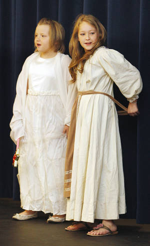 Photo - Fourth-graders Lillian Snead as the fairy godmother and Asher Bartlett as Cinderella perform in a play at John Glenn Elementary School.