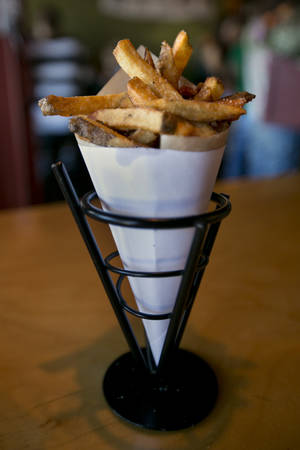Photo - This photo made Friday, July 12, 2013, shows Belgian fries made with local Maine potatoes fried in duck fat, at Duckfat, a small sandwich shop in Portland, Maine.  (AP Photo/Robert F. Bukaty)