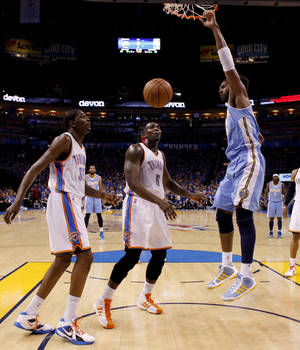 photo - Denver's Nene (31) dunks the ball beside Oklahoma City's Kendrick Perkins (5) and Kevin Durant (35) during the NBA basketball game between the Denver Nuggets and the Oklahoma City Thunder in the first round of the NBA playoffs at the Oklahoma City Arena, Sunday, April 17, 2011. Photo by Bryan Terry, The Oklahoman