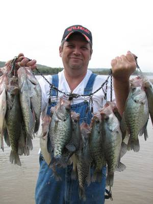 Photo - Leland Shanks of Longtown does some crappie dipping, or doodle-socking, in shallow water Tuesday on Lake Eufaula. Crappie have moved into the banks on Eufaula and other lakes around the state in preparation of the spawn. Photo provided