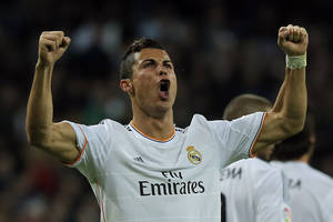 Photo - Real Madrid's Cristiano Ronaldo from Portugal celebrates his goal during a Spanish La Liga soccer match between Real Madrid and Sevilla at the Santiago Bernabeu stadium in Madrid, Spain, Wednesday Oct. 30, 2013. (AP Photo/Andres Kudacki)