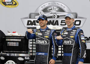 Photo - FILE - In this Feb. 24, 2013 file photo, Jimmie Johnson, left,  and crew chief Chad Knaus wear Daytona 500 rings after winning the Daytona 500 NASCAR Sprint Cup Series auto race at Daytona International Speedway in Daytona Beach, Fla. It was important to Johnson to win a Daytona 500 with crew chief Chad Knaus there. (AP Photo/Terry Renna, File) ORG XMIT: NY155