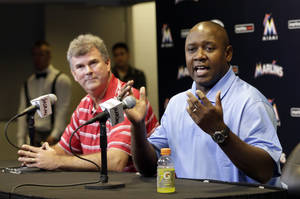 Photo - Miami Marlins' Michael Hill, right, talks to the media at a news conference after being promoted to president of baseball operations as new general manager Dan Jennings, left, looks on Sunday, Sept. 29, 2013, in Miami.  (AP Photo/Alan Diaz)