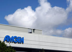 Photo - FILE - This April 20, 2010, file photo,shows an exterior view of Amgen offices in Fremont, Calif.  Biotech drugmaker Amgen Inc. reports quarterly earnings on Tuesday, Jan. 28, 2014.AP Photo/Paul Sakuma, file)