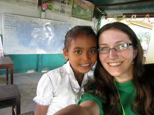 Photo -  Linzi Thompson poses with a young student in Cambodia during her trip in December. Thompson, a senior at East Central University in Ada, will be in China this summer. Photo Provided  <strong>PROVIDED</strong>