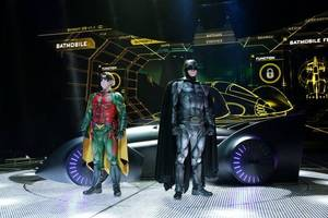 Batman and Robin pose in front of the Batmobile on the set of Batman Live at Oklahoma City's Chesapeake Energy Arena last month. KYLE ROBERTS/NewsOK.com