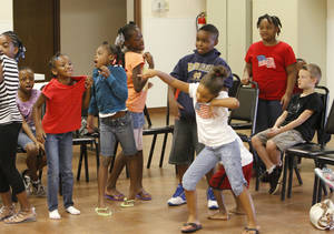 Photo - Children sing and dance during a group activity at Fairview Baptist Church's summer day camp. Photo by David McDaniel, The Oklahoman