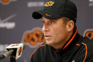 photo - OSU head coach Mike Gundy talks to the media after football practice at Oklahoma State University in Stillwater, Okla., Friday, Dec. 14, 2012. Photo by Nate Billings, The Oklahoman