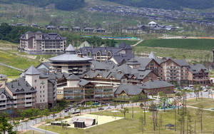 Photo - FILE - In this July 7, 2011 file photo, Alpensia resort, one of the venues for the 2018 Winter Olympics, is pictured in Pyeongchang, South Korea. The people of Pyeongchang can confidently promise two things when they host the Olympics: it'll be cold, and there'll be no concerns about snow. While a warm spell has created challenging conditions for the skiers and snowboarders competing in the mountains above Sochi at the 2014 edition, there's been heavy dumps of snow in the region that will host the next Winter Games in 2018.  (AP Photo/Lee Jin-man, File)