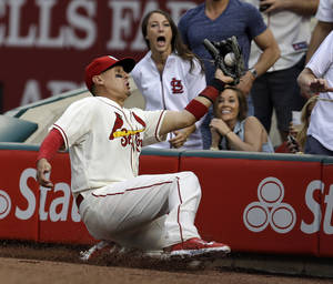 Photo - St. Louis Cardinals right fielder Allen Craig catches a ball hit by Pittsburgh Pirates' Gaby Sanchez in foul territory for an out during the sixth inning of a baseball game Saturday, April 26, 2014, in St. Louis. (AP Photo/Jeff Roberson)