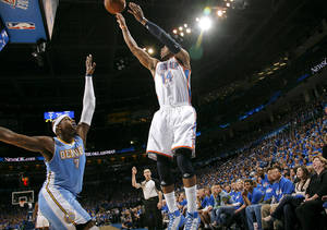 photo - Oklahoma City&#039;s Daequan Cook puts up a three point shot in front of Denver&#039;s Al Harrington during the first round NBA Playoff basketball game between the Thunder and the Nuggets at OKC Arena in downtown Oklahoma City on Wednesday, April 20, 2011. The Thunder beat the Nuggets 106-89 and lead the series 2-0. Photo by John Clanton, The Oklahoman