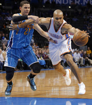 Photo - Oklahoma City Thunder's Derek Fisher (6) battles for the ball with New Orleans Hornets' Austin Rivers (25) during the NBA basketball game between the Oklahoma City Thunder and the New Orleans Hornets at the Chesapeake Energy Arena on Wednesday, Feb. 27, 2013, in Oklahoma City, Okla. Photo by Chris Landsberger, The Oklahoman