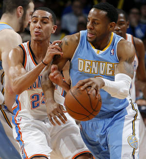 Photo - Denver's Andre Iguodala (9) goes past Oklahoma City's Kevin Martin (23) during an NBA basketball game between the Oklahoma City Thunder and the Denver Nuggets at Chesapeake Energy Arena in Oklahoma City, Tuesday, March 19, 2013. Denver won 114-104. Photo by Bryan Terry, The Oklahoman