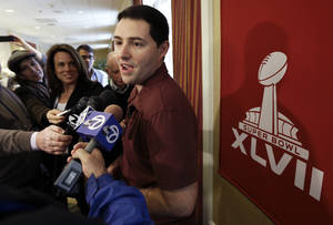 photo - San Francisco 49ers CEO Jed York talks with reporters on Thursday, Jan. 31, 2013, in New Orleans. It's been an exceptionally good few months for York, but he won't be happy until the 49ers are Super Bowl regulars again. The 49ers are scheduled to play the Baltimore Ravens in the NFL Super Bowl XLVII football game on Feb. 3. (AP Photo/Mark Humphrey)