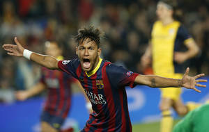 Photo - Barcelona's Neymar celebrates after scoring his sides first goal during a first leg quarterfinal Champions League soccer match between Barcelona and Atletico Madrid at the Camp Nou stadium in Barcelona, Spain, Tuesday April 1, 2014. (AP Photo/Emilio Morenatti)