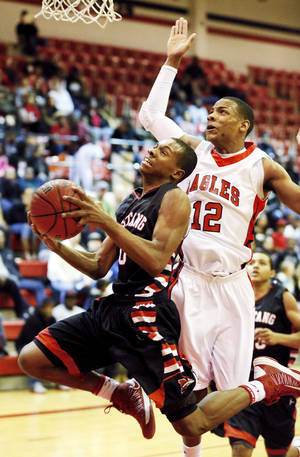 Photo - Mustang's Terrell Williams (10) moves to the hoop in front of Del City's Stephen Edwards (12) during a high school basketball game between Del City and Mustang at Del City High School in Del City, Okla., Thursday, Dec. 27, 2012.  Photo by Nate Billings, The Oklahoman