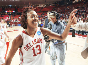 Photo - Oklahoma's Danielle Robinson leaves the court after the Sooners' NCAA Tournament win over Arkansas-Little Rock on Tuesday at Lloyd Noble Center. Robinson is one of 40 finalists for the State Farm Coaches All-America team. Photo by Steve Sisney, The Oklahoman