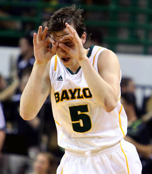 Photo - Baylor's Brady Heslip (5) reacts to a 3-point shot against Long Beach State during the first half of an NIT first-round college basketball game in Waco, Texas, Wednesday, March, 20, 2013. (AP Photo/Waco Tribune Herald, Rod Aydelotte)