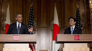 President Barack Obama, left, and Japanese Prime Minister Shinzo Abe participate in a joint news conference at the Akasaka State Guest House in Tokyo, Thursday, April 24, 2014. Obama is seeking to reassure Japanese leaders Thursday that he can deliver on his security and economic pledges to Asia even as the crisis in Ukraine demands U.S. attention and resources elsewhere. (AP Photo/Carolyn Kaster)