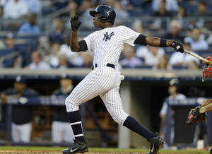 Photo - New York Yankees Alfonso Soriano watches his first-inning grand slam in a baseball game against the Los Angeles Angels on Wednesday, Aug. 14, 2013, in New York. (AP Photo/Kathy Willens)
