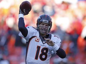 Photo - Denver Broncos quarterback Peyton Manning (18) warms up before an NFL football game against the Kansas City Chiefs, Sunday, Dec. 1, 2013, in Kansas City, Mo. (AP Photo/Orlin Wagner)