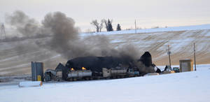 photo - This photo provided by Wibaux County Disaster and Emergency Services, shows an eastern Montana oil recycling facility destroyed by an explosion and a fire, which is still burning Monday, Dec. 31, 2012 two days after it began outside Wibaux, Mont. Three workers were injured in the explosion, but their conditions are not known. (AP Photo/Wibaux County Disaster and Emergency Services, Frank Datta)
