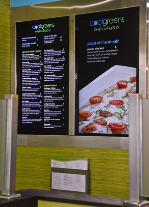 Photo - The menu is displayed on digital screens at Coolgreens in Edmond. <strong>CHRIS LANDSBERGER - THE OKLAHOMAN</strong>