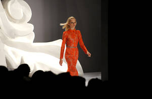 Photo -   A model walks the runway during the Carolina Herrera spring 2013 show, Monday, Sept. 10, 2012, during Fashion Week in New York. (Photo by Diane Bondareff/Invision/AP)