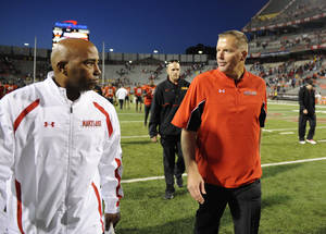 photo -   Maryland head coach Randy Edsall, right, walks off the field after defeating Wake Forest in an NCAA football game, Saturday, Oct. 6, 2012, in College Park, Md. (AP Photo/Nick Wass)
