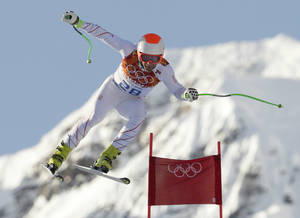 Photo - United States' Steven Nyman makes a jump during a men's downhill training run for the Sochi 2014 Winter Olympics, Friday, Feb. 7, 2014, in Krasnaya Polyana, Russia. (AP Photo/Charles Krupa)