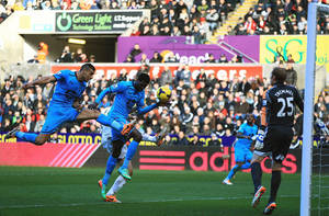 Photo - Tottenham Hotspur's Emmanuel Adebayor, centre, prior to scoring his team's opening goal, during the English Premier League soccer match against Swansea City,  at the Liberty Stadium, Swansea, Wales, Sunday Jan. 19, 2014. (AP Photo/PA, Nick Potts) UNITED KINGDOM OUT