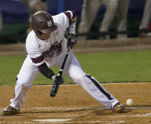 Photo - Mississippi State's Gavin Collins lays down a bunt during the Southeastern Conference NCAA college baseball tournament, against Georgia on Tuesday, May 20, 2014, in Hoover, Ala. (AP Photo/Hal Yeager)