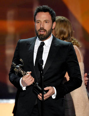 "Photo - Ben Affleck accepts the award for outstanding cast in a motion picture for ""Argo"" at the 19th Annual Screen Actors Guild Awards at the Shrine Auditorium in Los Angeles on Sunday Jan. 27, 2013. (Photo by John Shearer/Invision/AP)"