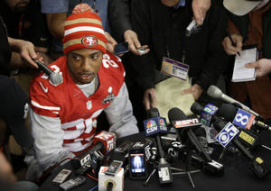 "photo - San Francisco 49ers cornerback Chris Culliver answers questions Thursday, Jan. 31, 2013, in New Orleans, regarding anti-gay remarks he made during Super Bowl media day Tuesday. Culliver apologized for the comments he made to a comedian, saying ""that's not what I feel in my heart."" The 49ers are scheduled to play the Baltimore Ravens in the NFL Super Bowl XLVII football game on Feb. 3. (AP Photo/Mark Humphrey)"
