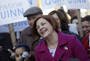 Photo - Surrounded by family and supporters, New York City Council speaker and mayoral hopeful Christine Quinn, center, laughs while speaking to the media as she announces her mayoral run in New York, Sunday, March 10, 2013. The New York City Council speaker has formally launched what she hopes will be a history-making mayoral bid this fall. (AP Photo/Seth Wenig)