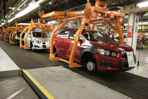 photo - In this April 25, 2012 photo, Chevrolet Sonics move down the line at the General Motors Orion Assembly plant in Orion Township, Mich. Nearly four years after GM filed for bankruptcy protection, the automaker is building the Sonic, the best-selling subcompact car in the nation. It's a vehicle no one thought could be made profitably in the U.S., by a company that few people thought would last. (AP Photo/Duane Burleson)
