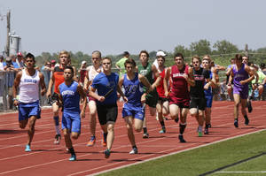 Photo - The field runs the first leg the boys 2 A 3200 meter relay at Carl Albert high school in Midwest City, Friday May 09, 2014. Photo By Steve Gooch, The Oklahoman