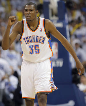 Photo - REACTION: Oklahoma City's Kevin Durant (35) reacts during game five of the Western Conference semifinals between the Memphis Grizzlies and the Oklahoma City Thunder in the NBA basketball playoffs at Oklahoma City Arena in Oklahoma City, Wednesday, May 11, 2011. Photo by Bryan Terry, The Oklahoman ORG XMIT: KOD