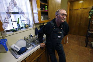 Photo - Elvin Fagan struggles with water issues at his rural home Thursday in Lexington. Photo by Steve Sisney, The Oklahoman <strong>STEVE SISNEY</strong>
