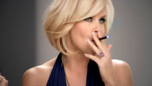 Photo - In this undated image from video provided by Resound Marketing in August 2013, Jenny McCarthy uses a blu eCig in a television advertisement. Electronic cigarettes have often been described as a less dangerous alternative to regular cigarettes. But there are few studies exploring exactly what chemicals are in them, and whether they are harmful. Some experts believe that at a time when cigarette smoking has finally become passe in popular culture, e-cigarettes may re-glamorize puffing away in public places. (AP Photo/Resound Marketing)