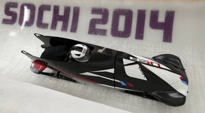 Photo - Elena Meyers and Katie Eberling of the United States take a turn during a training session for the women's bobsleigh at the 2014 Winter Olympics,  Friday, Feb. 14, 2014, in Krasnaya Polyana, Russia. (AP Photo/Michael Sohn)
