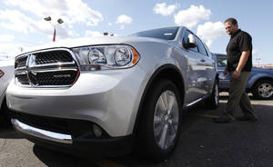 Photo - A Dodge Durango at a dealership in Warren, Mich.  AP Photo