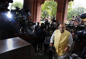 Photo - Indian Finance Minister Arun Jaitley arrives to present the 2014-15 union budget at the Indian parliament in New Delhi, Thursday, July 10, 2014. India's new government has introduced an ambitious reform-minded budget focusing on promoting manufacturing and infrastructure, raising the tax base and overhauling populist subsidies. (AP Photo/Manish Swarup)