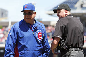 Photo - Chicago Cubs manager Rick Renteria departs after speaking with home plate umpire Mike Everitt about a foul ball call, during the third inning of a baseball game at Nationals Park, Sunday, July 6, 2014, in Washington. The play was not reviewed. (AP Photo/Alex Brandon)