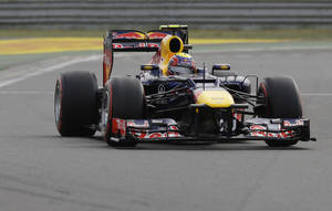 Photo -   Red Bull driver Mark Webber of Australia steers his car during the qualifying session of the Korean Formula One Grand Prix at the Korean International Circuit in Yeongam, South Korea, Saturday, Oct. 13, 2012. (AP Photo/Mark Baker)