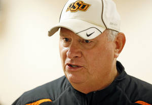 photo - OSU defensive coordinator Bill Young  talks to the media after football practice at Oklahoma State University in Stillwater, Okla., Friday, Dec. 14, 2012. Photo by Nate Billings, The Oklahoman