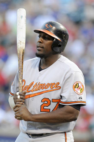 photo -   FILE - This July 5, 2011 file photo shows Baltimore Orioles designated hitter Vladimir Guerrero during an at bat in the third inning of a baseball game against the Texas Rangers, in Arlington, Texas. Former major-leaguer Guerrero says he has turned himself over to police in the Dominican Republic after reportedly being involved in a scuffle with a police officer in a disco. (AP Photo/Matt Strasen, File)