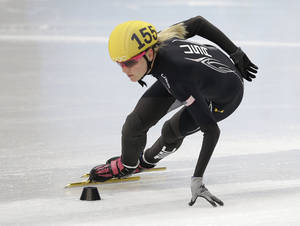 Photo - Emily Scott of the United States practices during a short track speedskating practice session at the Iceberg Skating Palace during the 2014 Winter Olympics, Friday, Feb. 14, 2014, in Sochi, Russia.  (AP Photo/Darron Cummings)